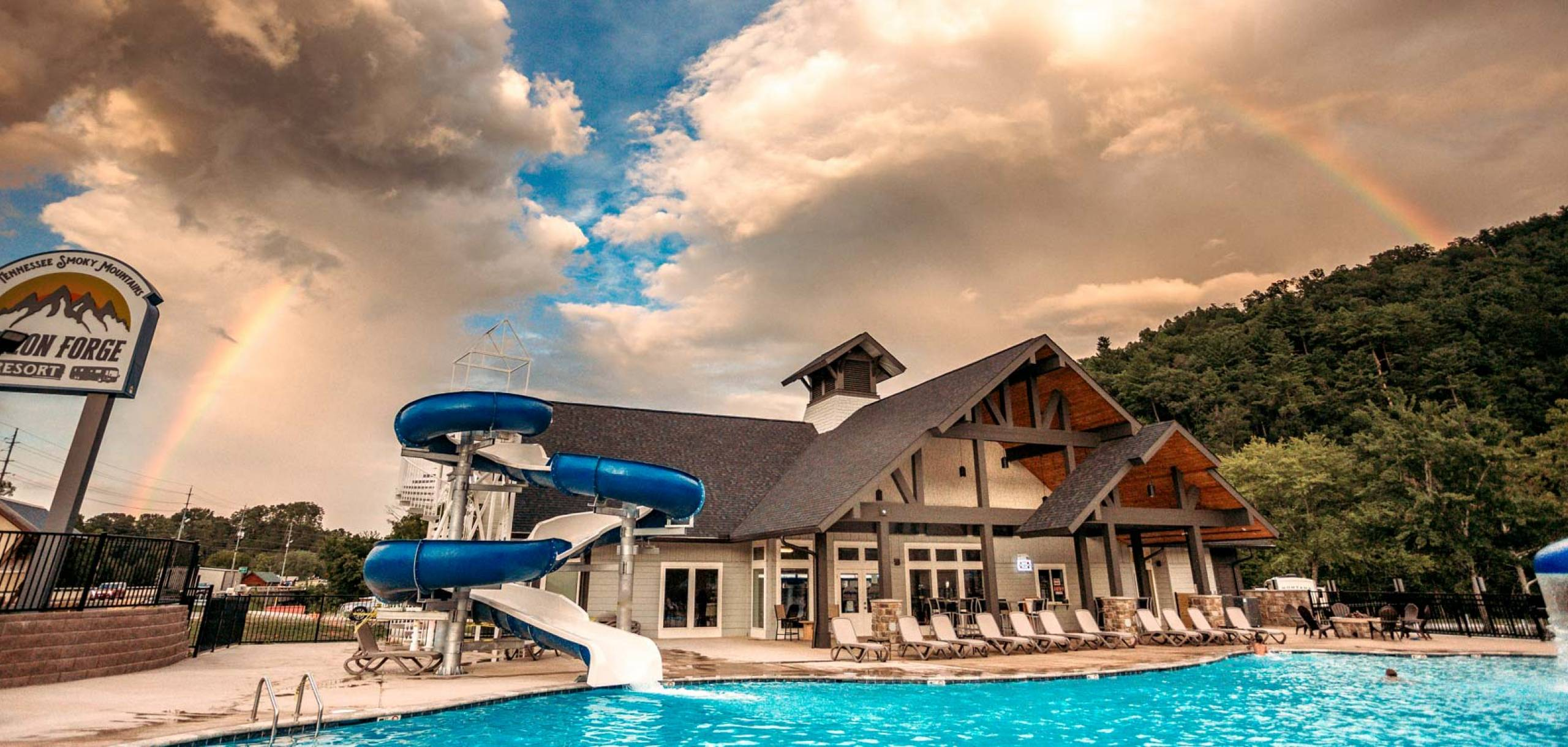 Pigeon Forge RV Resort Pool and Slide with Rainbow.