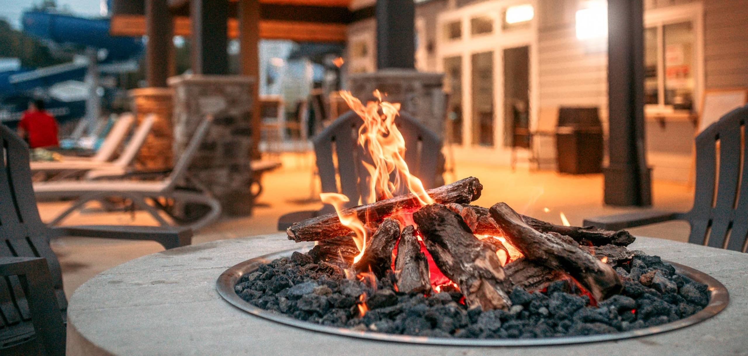 Pigeon Forge RV Resort Firepit with TVs and Lounge Area